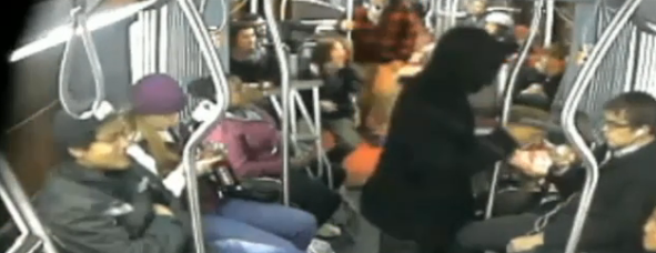 Surveillance video still of robber on the bus