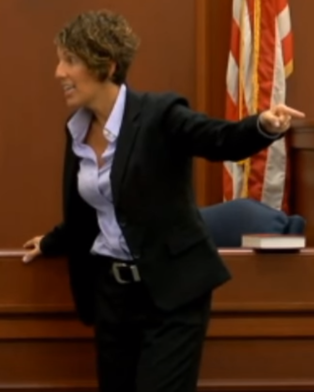 Prosecutor pointing at Sidney Moorer